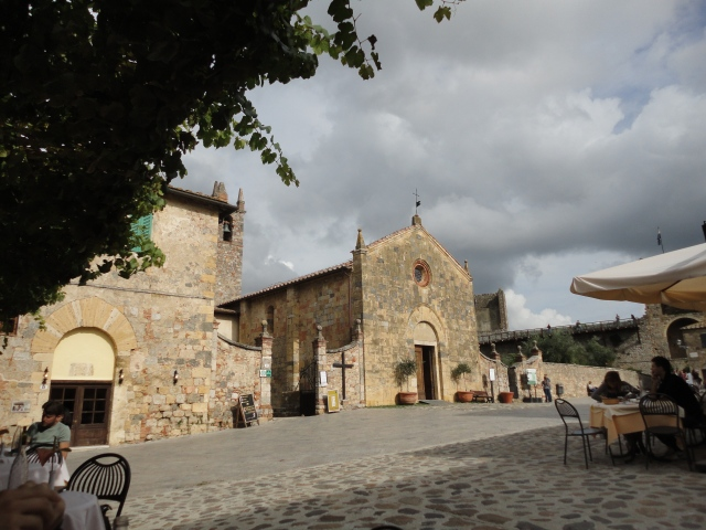 View of the main square of Monteriggione seen from Il Pozzo